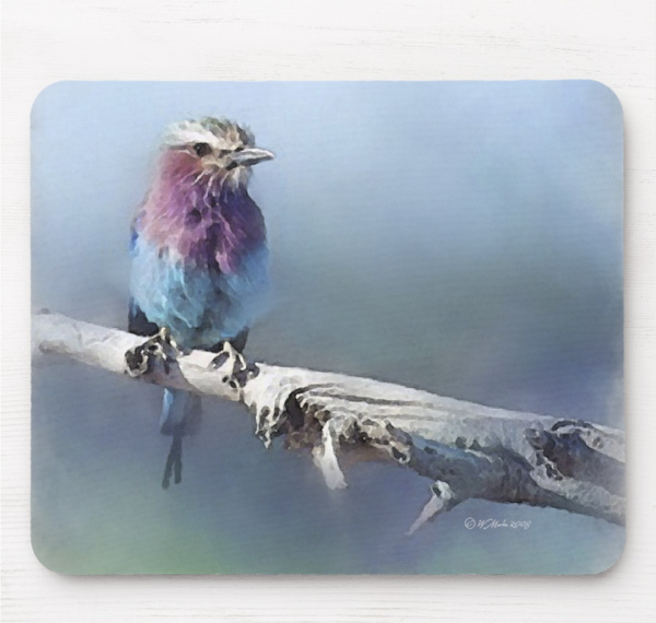 A wonderful mouse pad featuring a beautiful songbird on a branch.